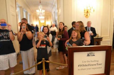 双语新闻:白宫取消拍照禁令